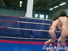 Wrestling dyke fingered in a boxing ring
