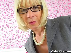 English gilf Elaine sits on a dildo