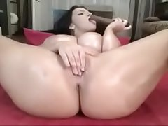 Oiled busty milf performing on a camshow - www.sinsexgirls.com
