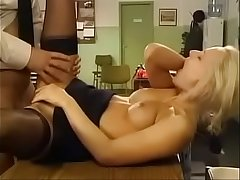 Blonde Police Woman Has Sex On Desk in Black Stockings