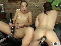 Lesbo babes pleased with dildo machines