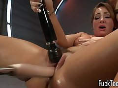 Ginger lesbian drilled in pussy with machine