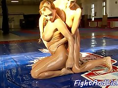 Busty wrestling babe oiled and pussylicked