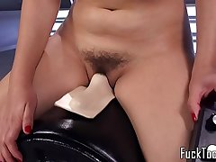 Busty babe screams while riding sybian